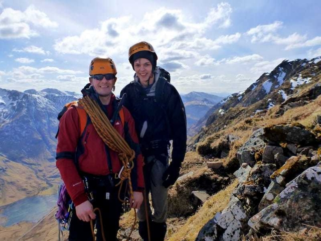 Father and son winter day adventure - Aonach Eagach Ridge Scotland