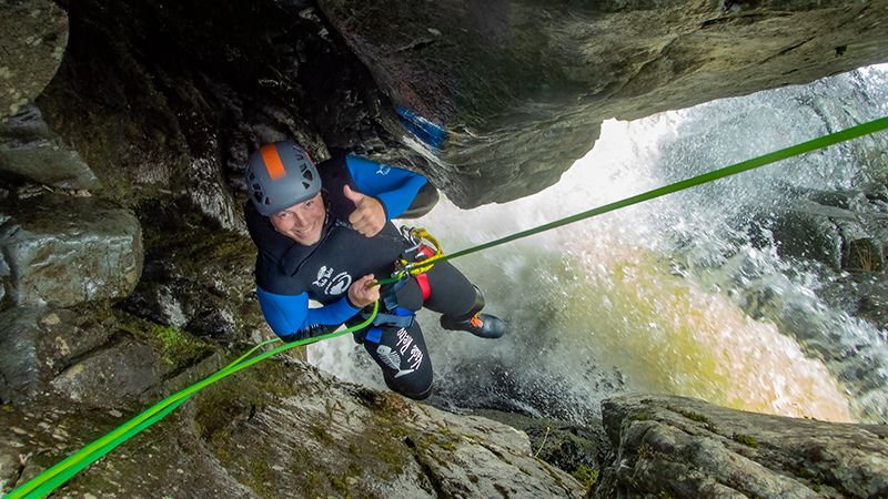 Awesome_fun_a_person_abseiling_down_the_funnel_in_Longsleddale_canyon