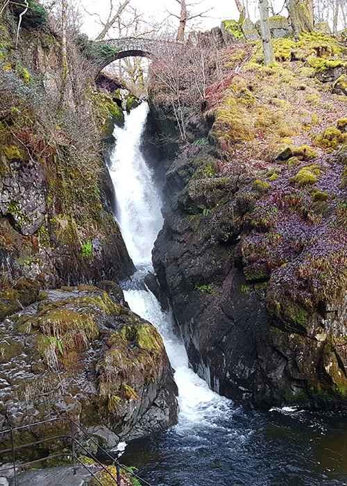 The main waterfall of Aira Force, tumbling below its stone bridge
