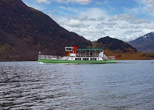 One of the 5 Ullswater steamers the Western Belle is steaming its way along the Ullswater Lake