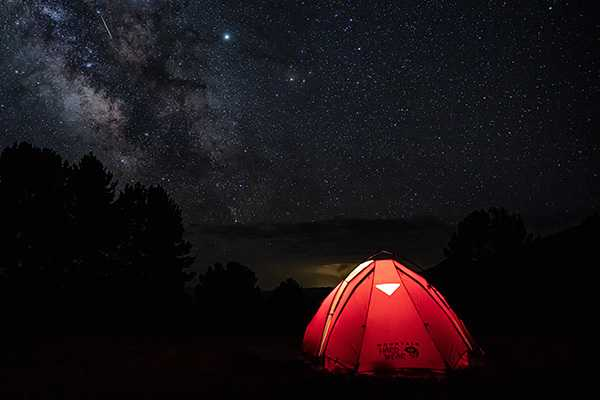 camping out under the clear night sky with the stars
